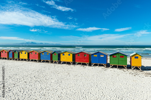Obraz na plátně Muizenberg beach with colorful wooden beach cabins huts, Cape Town, South Africa