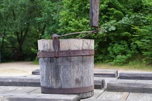 Old Wooden Bucket Standing On The Lid Of A Village Well