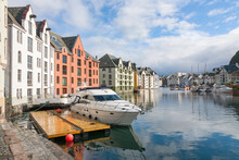 Beautiful Architecture And A Boat In Alesund, Norway