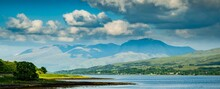 A Large Body Of Water With A Mountain In The Background. (Ben Nevis The Grampian Mountains In The Highland Region Of Lochaber)