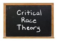 Critical Race Theory Written In White Chalk On A Black Chalkboard Isolated On White