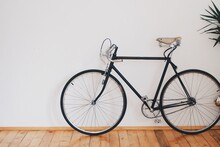 Vintage Bicycle On A Wooden Background