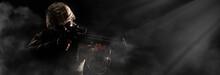 US Army Soldier In Combat Uniforms Holding Machine Gun Ready To Attack In Smoke Around On Dark Background. Silhouette Soldier, Veterans Day, Patriot Concept In Banner Size