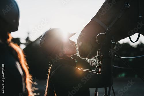 Fototapeta Beautiful young woman enjoying with her horse.