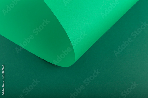 Foto Design background of folded curl from green cardboard