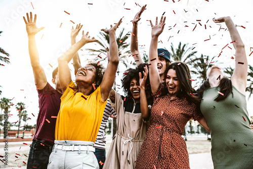Canvas Group of friends enjoying party throwing confetti in the air - Multicultural you