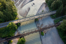 Aerial View Of A Roadway And A Train Trestle Over A River In The Pacific Northwest. Highway 9 Crosses The Nooksack River Near The Town Of Deming, Washington In This Sunrise Drone View.