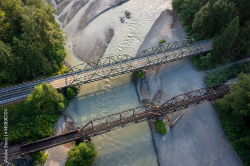 Obraz na plátně Aerial view of a roadway and a train trestle over a river in the Pacific Northwest