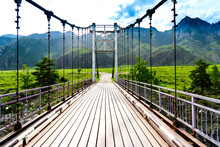 Way To Other Side, Old Steel Suspension Bridge Over Mountain River