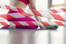 Prohibition Tapes For Gym Due To Sanitary Measures. Closeup Of Fit Sporty Woman Rolling Yoga Mat