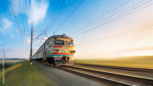 Fotografie, Obraz A passenger train on the railway is moving at high speed