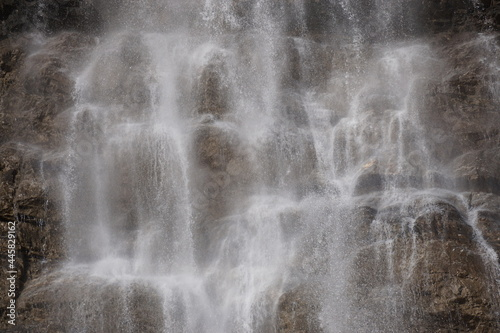 closeup of a waterfall on the rocks on a windy day  in the moutains of the alps, france