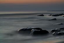 Seascape Of Rock Light Sunset, Long Exposure