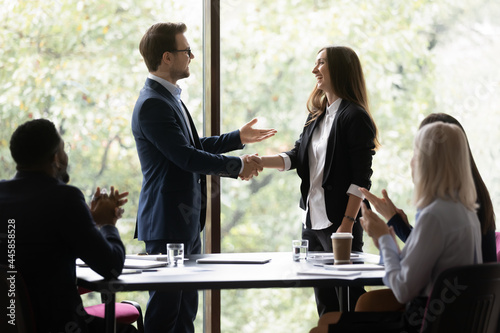 Photo Business team leader congratulating employee on hiring, promotion, high work result, expressing recognition