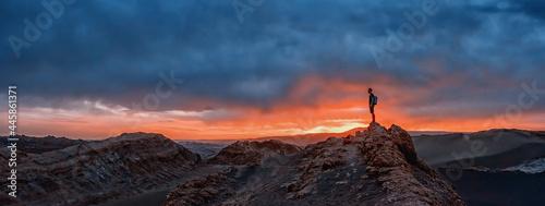 Canvas-taulu Tourist watching the sunset at the Valle de la Luna, Atacama desert, Chile