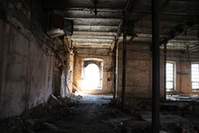Old Abandoned Factory Building Interior With Columns, Light In Windows