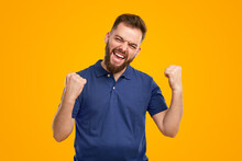 Excited Bearded Man Celebrating Victory