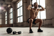 Muscular Man Doing Squats In Gym