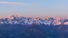 Snowy Mountain Range During Sunrise