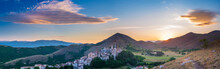 Sunset Over Medieval Village Perched On Hill Top, Santo Stefano Di Sessanio, Abruzzo, Italy. Romantic Sky And Clouds Above Mountains Landscape, Tourism Destination.