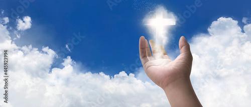 Billede på lærred Concept of new idea with Christian cross glowing symbol of Jesus on hand in 3D illustration