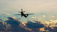 The Plane Is Landing Against The Backdrop Of A Dramatic Sky At Sunset. Airlines, Flight, Travel, Tourism, Trip.