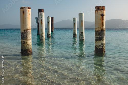 Canvas Print Old Pier Ruins in Caribbean Water at Île à Rat beach in Haiti