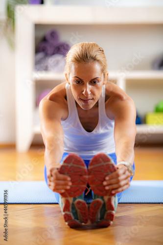 Fototapeta premium Home Exercising. Woman Stretching at Home