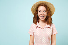 Widely Smiling Funny Humorous Young Redhead Curly Woman 20s Wears Casual Pink Dress Straw Hat Look Camera Isolated On Pastel Blue Color Background Studio Portrait. People Emotions Lifestyle Concept