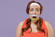 Young Scared Sad Chubby Overweight Plus Size Big Fat Fit Woman Wear Red Top Gagged With Measuring Tape Warm Up Training Isolated On Purple Color Background Gym Home Workout Motivation Sport Concept