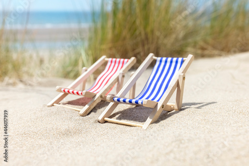 Summer beach vacation, two deck chairs Fototapet