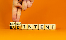 Good Or Bad Intent Symbol. Businessman Turns Wooden Cubes And Changes Words 'bad Intent' To 'good Intent'. Beautiful Orange Table, Orange Background. Business, Bad Or Good Intent Concept. Copy Space.