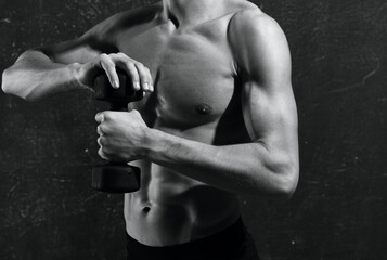 Fototapeta na wymiar man with a pumped-up torso in gloves workout exercises muscles