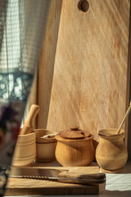 Wooden Household Dishes And Cutting Board On The Windowsill