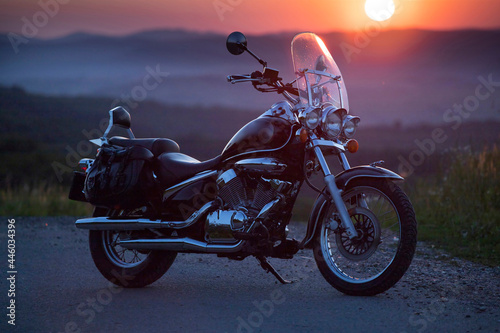 Motorcycle parking on the road right side and sunset Fotobehang