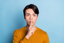 Photo Of Young Guy Cover Lips Finger Shh Keep Secret Confidential Shut Up Isolated Over Blue Color Background