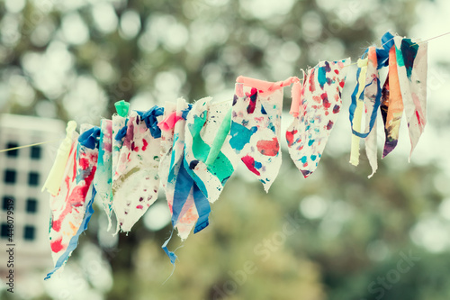 Fotografia Closeup of colored handkerchiefs on the rope outside.