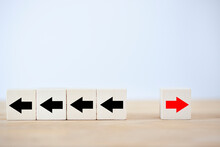 One Red Wooden Block And Black Arrows To Show Concept Move On, Think Different And Individual Standing Out From The Crowd And Unique Think Different.
