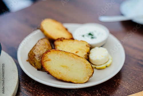 Obraz na plátně Delicious jacked potatoes on the plate in the restaurant