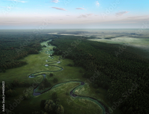 Fotografering Soomaa national park and small curvy river from birds eye view during sunrise