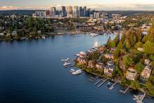 Aerial Of Bellevue From A Bay With Boats At Sunset Where You Can See The City's Reflection
