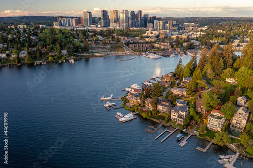 Fotografia, Obraz Aerial of Bellevue from a Bay with Boats at Sunset where you can see the City's