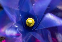 Blue Spinning Pinwheel With Yellow Center