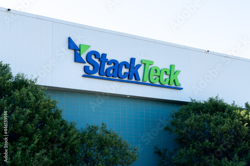 Fototapeta premium Brampton, On, Canada - July 10, 2021: Close up of StackTeck sign on their headquarters building in Brampton, On, Canada. StackTeck Systems Ltd. is a Canadian injection mold manufacturer.