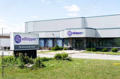 Fototapeta premium Brampton, On, Canada - July 10, 2021: eShipper+ headquarters in Brampton, On, Canada. eShipper+ is a Canadian shipping company offers end-to-end shipping services.