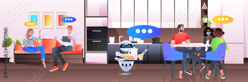 Fotografie, Obraz modern robot waiter serving food to businesspeople in office artificial intellig