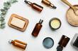 Leinwandbild Motiv Different cosmetic products and sea salt on light background