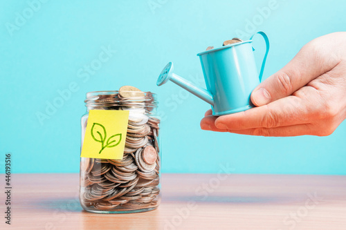 Canvas Print The coins are stored in a glass jar to accumulate finances.