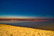 Beautiful Seascape With Sandy Coast Under A Dark Blue Sky At Sunset