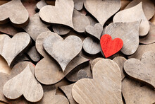 Wooden Hearts, One Red Heart On The Heart Background..